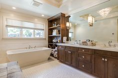 High-End bathroom addition built with luxury appliances, custom vanity, tub, and walk Cleaning Closet, Bathroom Cleaning, Add A Bathroom, Bathroom Faucets, Bathroom Ideas, Bathrooms, Clean Shower Curtains, Installing Tile Floor, Mudroom Laundry Room