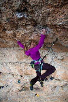 Hazel Findlay catches a good hold on a tough section of the pump-fest of Kalea Borroka (8b+) in Siurana, Spain. Credit: Jack Geldard - UKC