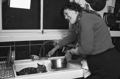 """Julia Child's oh-so-adorable sous chef doesn't seem to be doing very much here! -- Click through for a fascinating read about the book """"Julia's Cats: Julia Child's Life in the Company of Cats,"""" released in time for what would have been her 100th birthday, Aug. 15, 2012. Much of recounting """"the latest mischief of her beloved poussiequettes"""" is in her own words."""