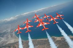Precision: The team is shown flying in tight formation in an image from the book, which will raise money in memory of pilots Flt Lt Jon Egging and Flt Lt Sean Cunningham, who both died last year