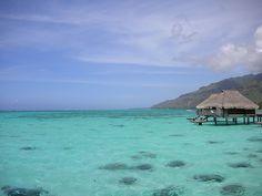Moorea, Tahiti.  Hiking, fishing, food, French, bungalows over beaches.  Oui, merci.