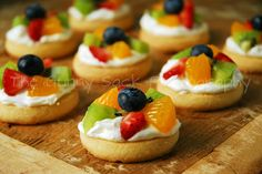 Mini Fruit Pizza.  Use sugar cookies and this instead Cream Cheese Layer:    8 oz. Cream Cheese (softened)  1 C Powdered Sugar  1 tsp. Vanilla  8 oz. Cool Whip    Mix together cream cheese, powdered sugar and vanilla. Beat until smooth, then fold in the Cool Whip and stir well. Spread cream cheese layer over cooled sugar cookie.