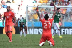 Netherlands Stuns Mexico With Late Goals To Reach World Cup Quarterfinals - Netherlands' forward Memphis Depay celebrates at the end of a Round of 16 football match between Netherlands and Mexico at Castelao Stadium in Fortaleza during the 2014 FIFA World Cup on June 29, 2014.