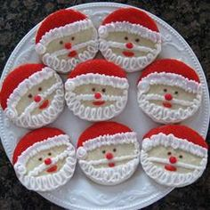 "A simple round cookie is the canvas for these adorable Santa cookies. ""Like"" if this looks like something you could pull off. (The Best Rolled Sugar Cookies)"
