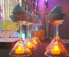 Cupcake presentation with wine glasses and battery operated tea lights