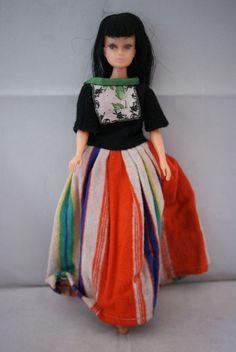 teenage Barbie clone doll black hair bangs cat eyes 60 s