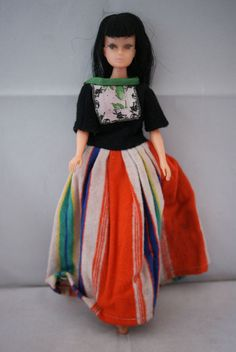 teenage Barbie clone doll black hair bangs cat eyes 60 s