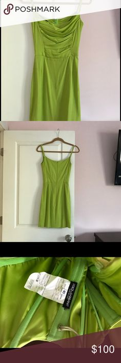 Dolce and Gabbana lime green silk dress This lime green silk dress is classic Dolce. It sucks you in with the inside corset and hugs every curve.  Has a few faint stains on the skirt which are barely noticeable (please see pic). It is beautiful! Dolce & Gabbana Dresses Mini