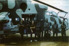 Cuban pilots with Angolan soldiers and Soviet officer after a rescue operation behind enemy lines in 1987.