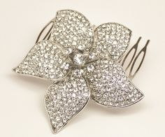 """This gorgeous rhinestone bridal hair comb features an elegant flower design with a cluster center of cz rhinestone surrounded by petals with hundreds of smaller cz jewels.  This beautiful comb is perfect for your an elegant, or romantic wedding day look.    Measures approximately 3""""."""
