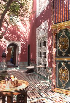 Sun-dappled courtyard at Riad Kaiss in Marrakech, Morocco