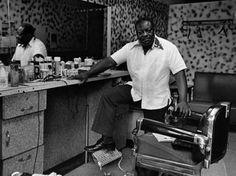 Black America captured in photographs of 1970s 'Harlem, U.S.A - Deas McNeil, the Barber, 1976