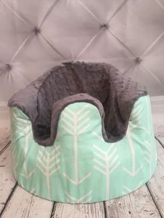 Mint arrows wth gray minky Bumbo covers-My little one only used his Bumbo seat for 2-3 months though !