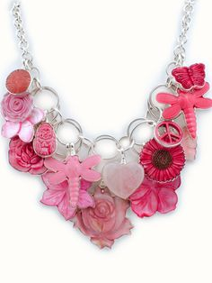 """A pink-themed charm necklace to honor those battling breast cancer.  This necklace is titled """"Pink Awareness"""". It is full of wonderful pink attachable charms 16 in all and is on our very popular multi-layer chain. Measures 15.5-17.5"""" in length. This chain provides the perfect pallet for arranging beautiful charm creations. Each pendant is carefully bezel-wrapped in silver and capped with our signature hook on top.  This allows the charm to move from necklace to bracelet to zipper pull and…"""