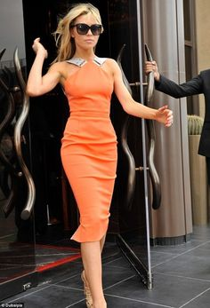 Abbey Clancy in Victoria Beckham Spring 2012 Tangerine Stretch-crepe Dress, and Azzedine Alaia Studded Platform High Heels