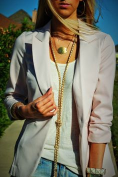 I am loving how she layered these necklaces. Chic & sassy:)