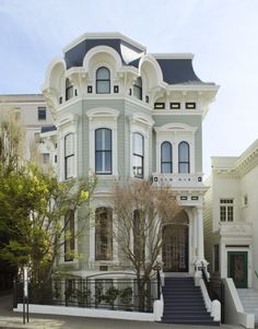 The roof and window arch detail on this imposing San Francisco Victorian, along with great details in all the other white portions, are wonderful!  Too bad they hide it all in a wimpy white and barely-there mint green.  The architectural magnificence of this house deserves to be seen!