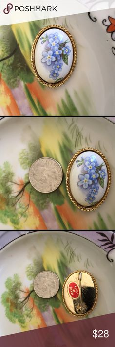 Beautiful Italian Porcelain Floral Brooch Easter is coming up and this would be such a beautiful brooch to wear! I believe this is Handpainted. As pictured made in Italy. Purchased at estate sale. No lowball offers will be accepted. Thank you for looking. I believe these are forget me not flowers. Jewelry Brooches