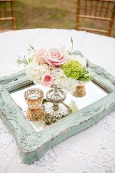 Vintage mirror with vase and flowers and pearls