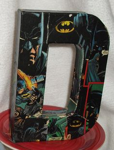 Mod Podged old comic books over wooden letters
