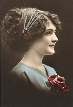 Edwardian glamour postcard showing a model with a fashionable bandeau headdress in the Grecian style.  The Spanish Comb on Ruby Lane.