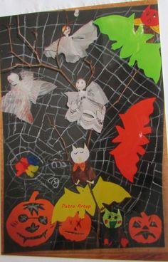 Halloweenbild von Kindern selber gestaltet ,alles ausgeschnitten das Spinnennetz mit Wachsmalkreide gemalt,  die Gespenster aus alten Gardienen gebastelt und mittig ein zweig aus der Natur