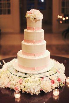 Flowers under glass tier of wedding cake. GORGEOUS!