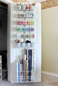 Elfa behind the door wall system for organizing crafts, gift wrap and supplies.  Such a great way to maximize space.  Iheartorganizing