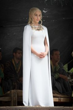 SEASON 5 - Episode 7 Daenerys again adopts a white dress to symbolise her purity of heart whilst watching men die in a fighting pit. The necklace of this dress features a three-headed dragon, the Targaryen sigil.