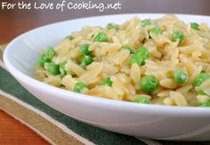 ORZO WITH PEAS AND PARMESAN  Time: 15 min.Total Time: 20 min.  INGREDIENTS:  2 tsp butter  2 tsp olive oil  1/4 sweet yellow onion, finely diced  2 cloves of garlic, minced  8 oz orzo  2 cups of chicken broth  Sea salt and freshly cracked pepper, to taste  1 cup of frozen peas  2-3 tbsp parmesan cheese (or more if desired)