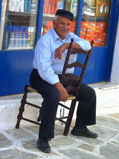 Passing time, Greek man with his komboloi in Chalki, Naxos island,