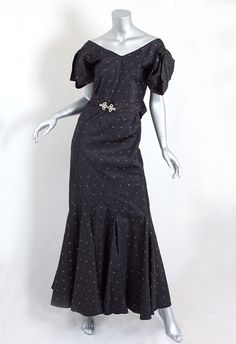 Black taffeta evening dress with embroidered bronze crescents, belt with rhinestone buckle, and bow at center back, 1930s.