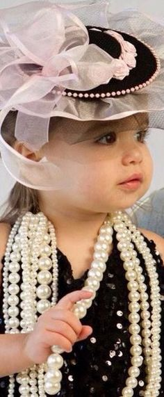Never too young to learn to appreciate a lovely hat and pearls!  How sweet.  What beautiful eyes!