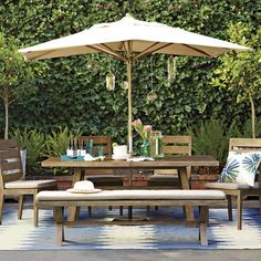 For the Pool Deck: Outdoor dining with cushioned seating on chairs and long bench.  Center umbrella a must for bright, sunny days lunching by the pool.