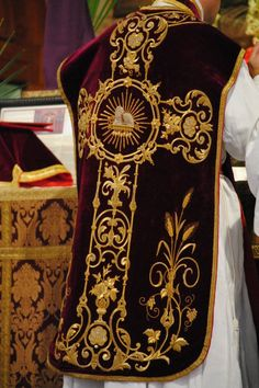 black latin mass vestment with gold embroidery