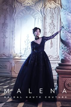 Countessa – Resplendent in glittery midnight blue, with a modern twist of the Victorian bustle skirt.