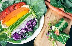 Sturdy collard greens make excellent nutrient-dense wrappers. In this recipe, they are stuffed with raw vegetables in every color of the rainbow.