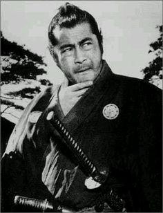 "Yojimbo (Toshiro Mifune, Tatsuya Nakadai, Takashi Shimura).  Dir. Akira Kurosawa.  This was later ""remade"" and was the film that made Clint Eastwood famous, in its cowboy version ""Fistful of Dollars""."