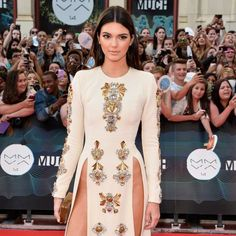 "8 Times Kendall Jenner's Dresses Came Dangerously Close to a Wardrobe Malfunction: <p>Models have an affinity for wearing <a href=""https://www.popsugar.com/fashion/amfAR-New-York-Gala-Red-Carpet-Dresses-2016-40143072"">the sexiest dresses on red carpet</a>, and Kendall Jenner is no exception. She always stuns us in barely there designer gowns that show off her back or mile-long legs. Her <a href=""https://www.popsugar.com/fashion/Kendall-Jenner-La-Perla-Dress-Met-Gala-2017-43489871"">2017 Met…"