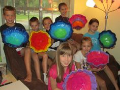 My summer art camp students proudly showing off their paper mache bowls! lesson designed by art teacher: Susan Joe