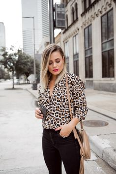 e7f5681d05e Houston fashion blogger Uptown with Elly Brown wears a Zara leopard top  with high waisted jeans