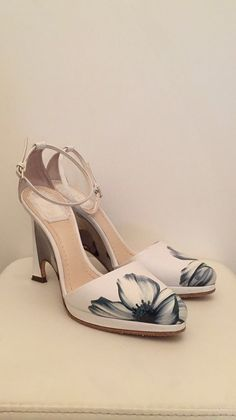 Dior shoes ,white with a flower 🌸.  Perfect for a special night ✨