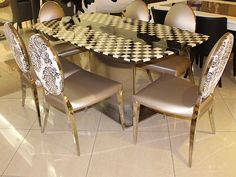 Stainless Steel Dining Furniture Set with Italian 6 leatherette chairs with stainless steel legs and marble top in chess pattern.