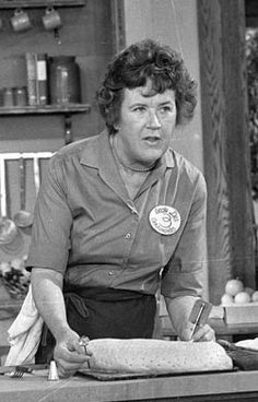 Television cooking personality Julia Child prepares a French delicacy in her cooking studio in this Nov. 24, 1970, file photo.