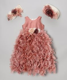 Becoming the belle of the ball may seem like it takes a lot of effort, but with this fancy frock, it just takes a quick zip up the back. Wispy feathers and a beautiful sash along with the option to don a beanie or headband make the look downright darling. Includes dress, beanie and headband