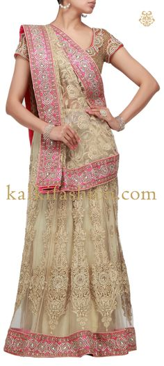 Buy it now http://www.kalkifashion.com/heavily-embroidered-lehenga-in-beige-with-kundan-and-zardosi-work-hand-made.html  Heavily embroidered lehenga in beige with kundan and zardosi work-Hand Made