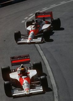 Ayrton Senna, McLaren-Honda, #27, (finished 1st), leading team mate Gerhard Berger, #28, (finished 3rd), Monaco GP, 1990