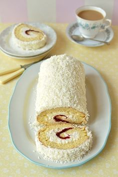 Coconut & cherry swiss roll cake, a light, fatless sponge filled with cherry jam & coconut swiss meringue buttercream, topped with desiccated coconut, this is the perfect cake for Easter. Cake Roll Recipes, Dessert Recipes, Jelly Roll Cake, Jelly Rolls, Swiss Roll Cakes, Kolaci I Torte, Cake Fillings, Cupcake Cakes, Cupcakes