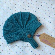 Hand knitted baby aviator hat in teal merino by SnugCreations