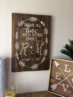 love each other wood sign